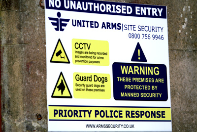 picture of united arms guard dog sign